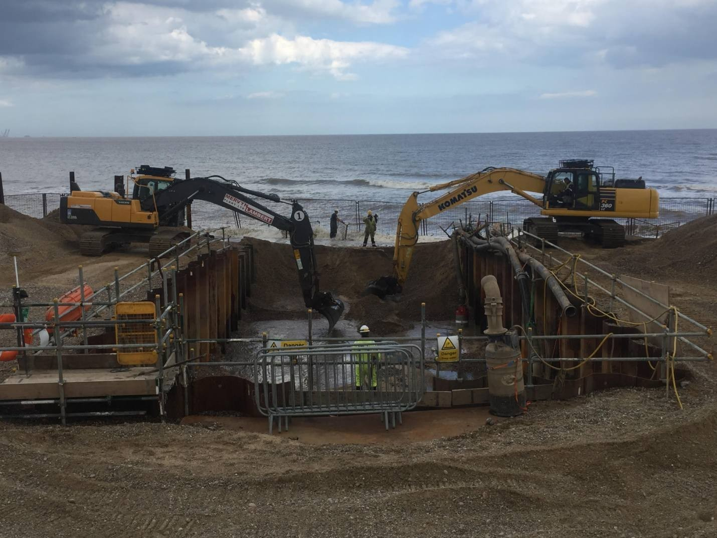 Figure 6 Excavators chasing the outgoing tide