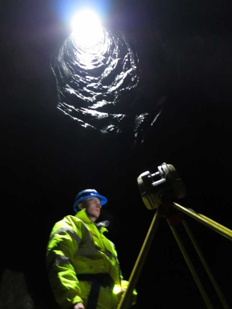Figure 2 Matt Ingram at the bottom of the shaft with the Topcon GLS2000