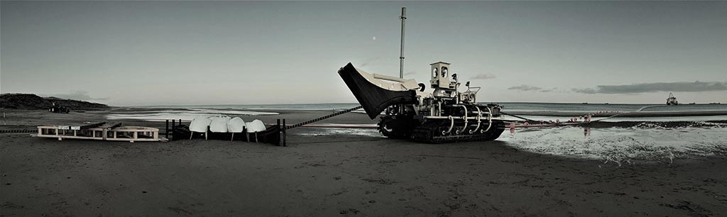 Vessel trenchformer and quadrent installed on beach