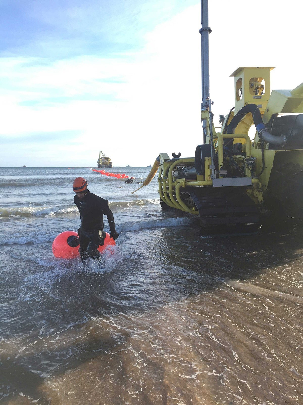 Wet riggers removing buoys from cable